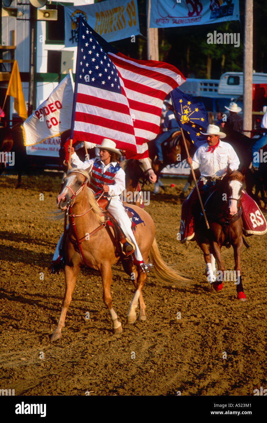 Cowgirl Carrying American Flag Riding Palomino Horse And Cowboy Stock Photo Alamy