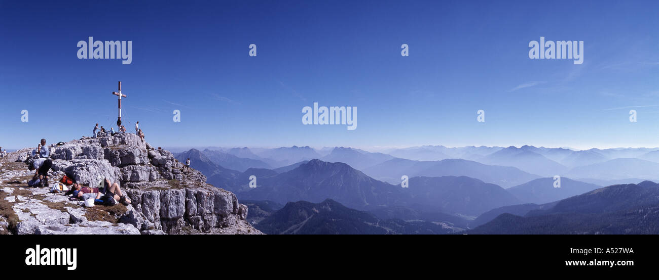 people on the mountain top overview at the mountain range Stock Photo