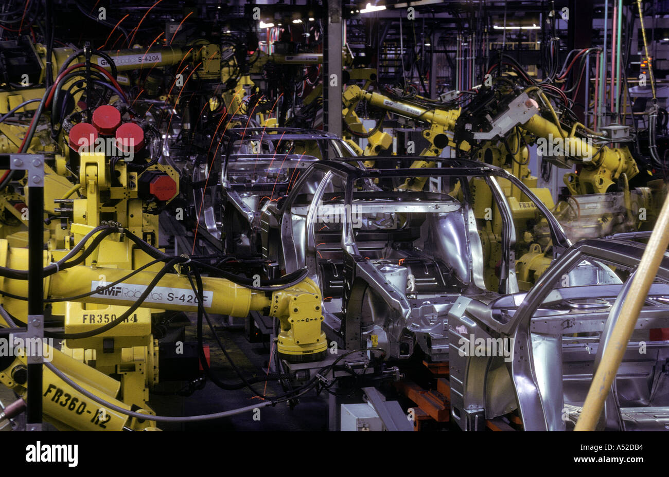 welding robots in use at automobile assembly plant in Ohio - Stock Image