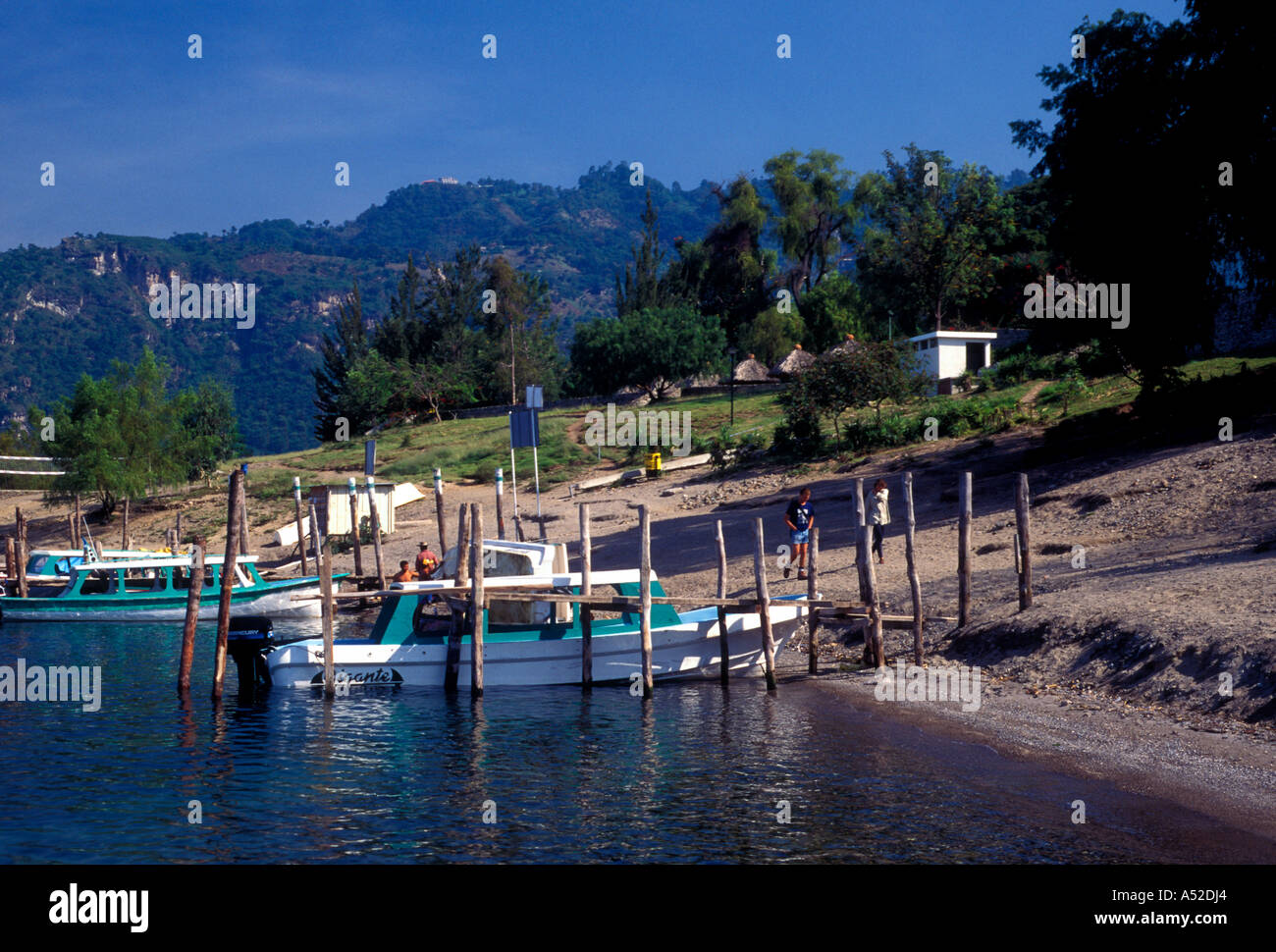 Boats at dock ferry boat service on Lake Atitlan in the town of Panajachel in Solola Department Guatemala Central Stock Photo