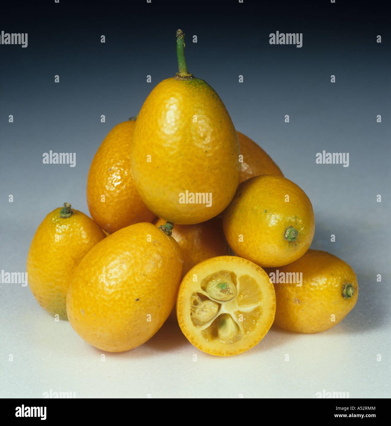 Whole and section kumquat fruit variety Oval - Stock Image