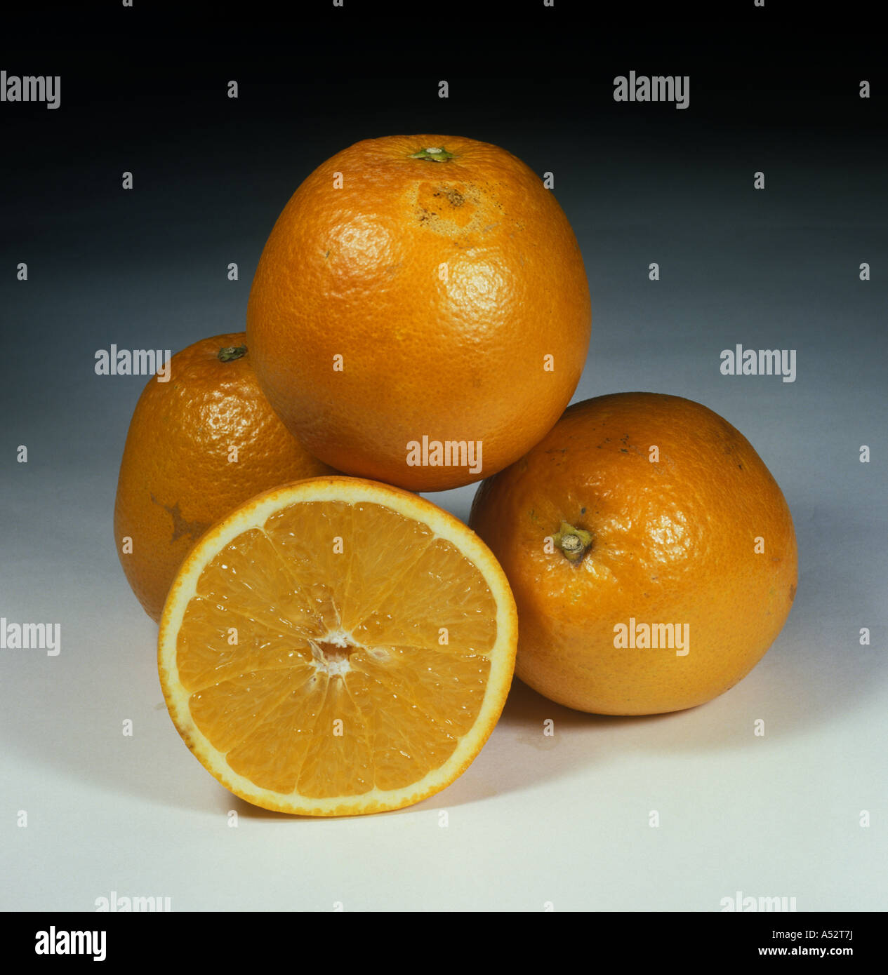 Whole sectioned citrus fruit orange variety Pera - Stock Image
