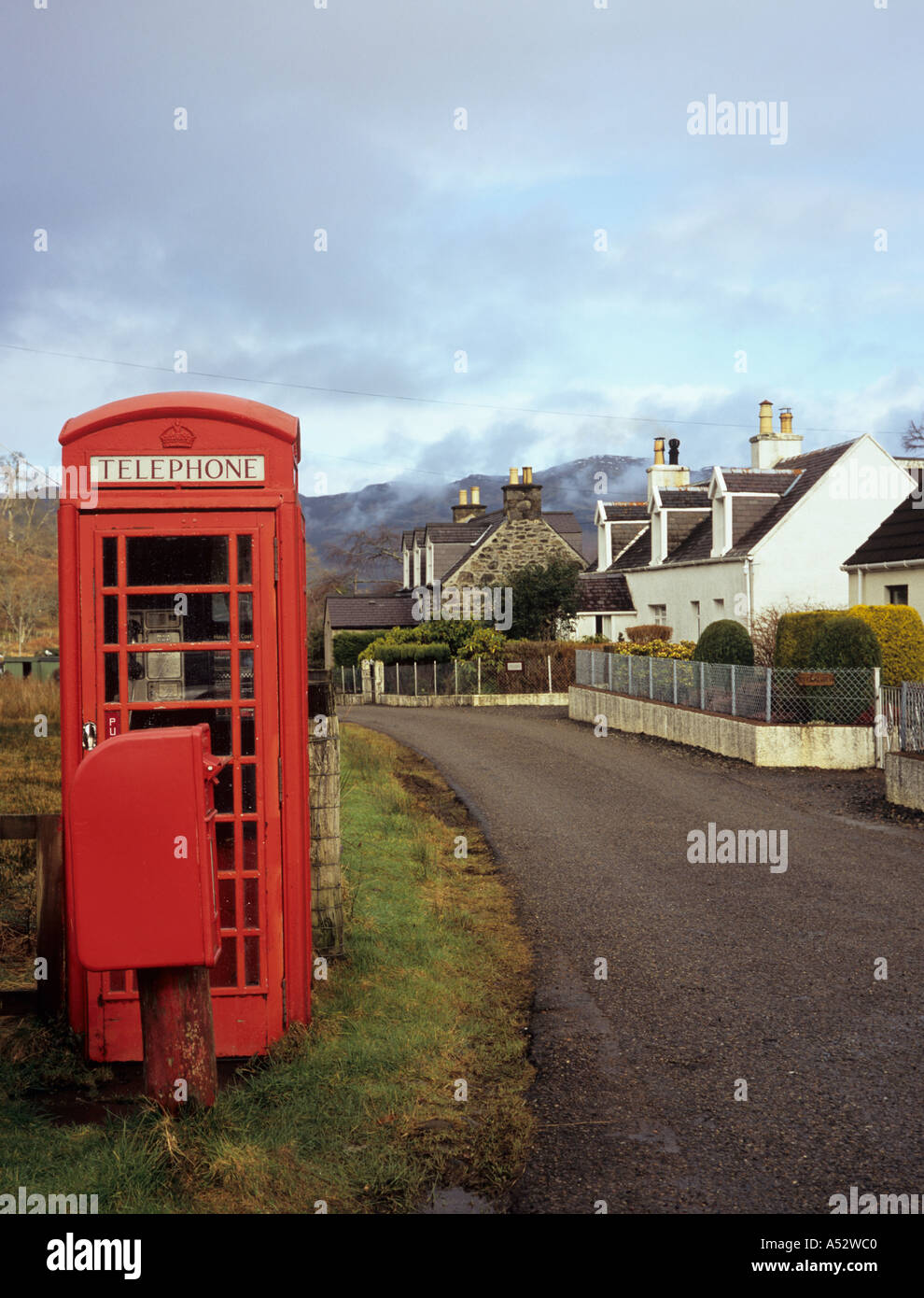 RED TELEPHONE BOX K6 and post box beside single track road through village of Letterfearn Highland Scotland UK Britain - Stock Image