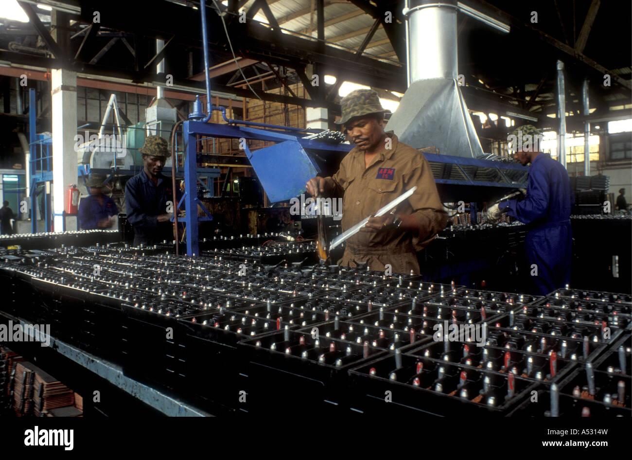 Skilled workers making car batteries in a factory in Nairobi Kenya East Africa - Stock Image