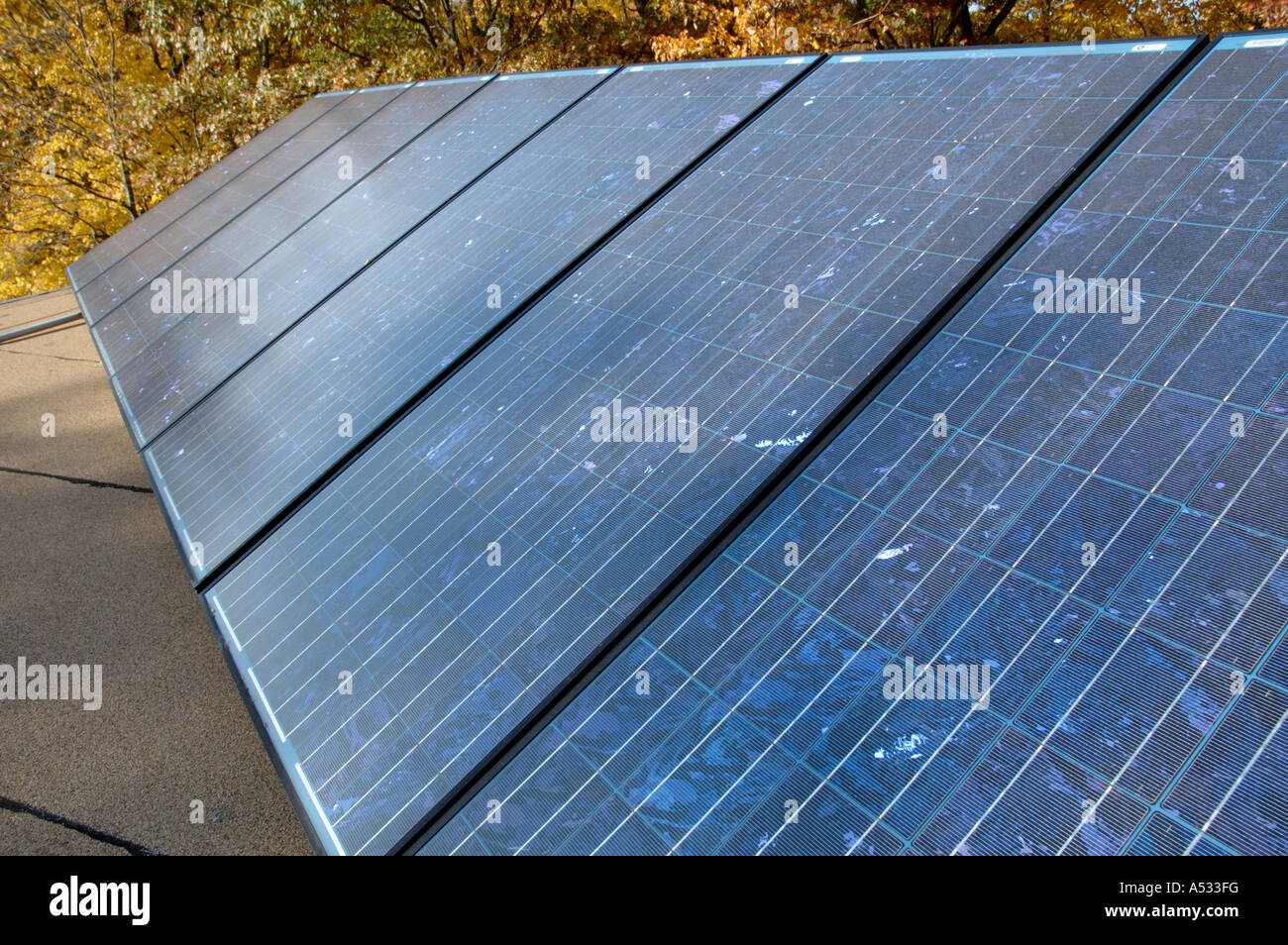 Array of photovoltaic solar power energy panels on the roof of a home - Stock Image