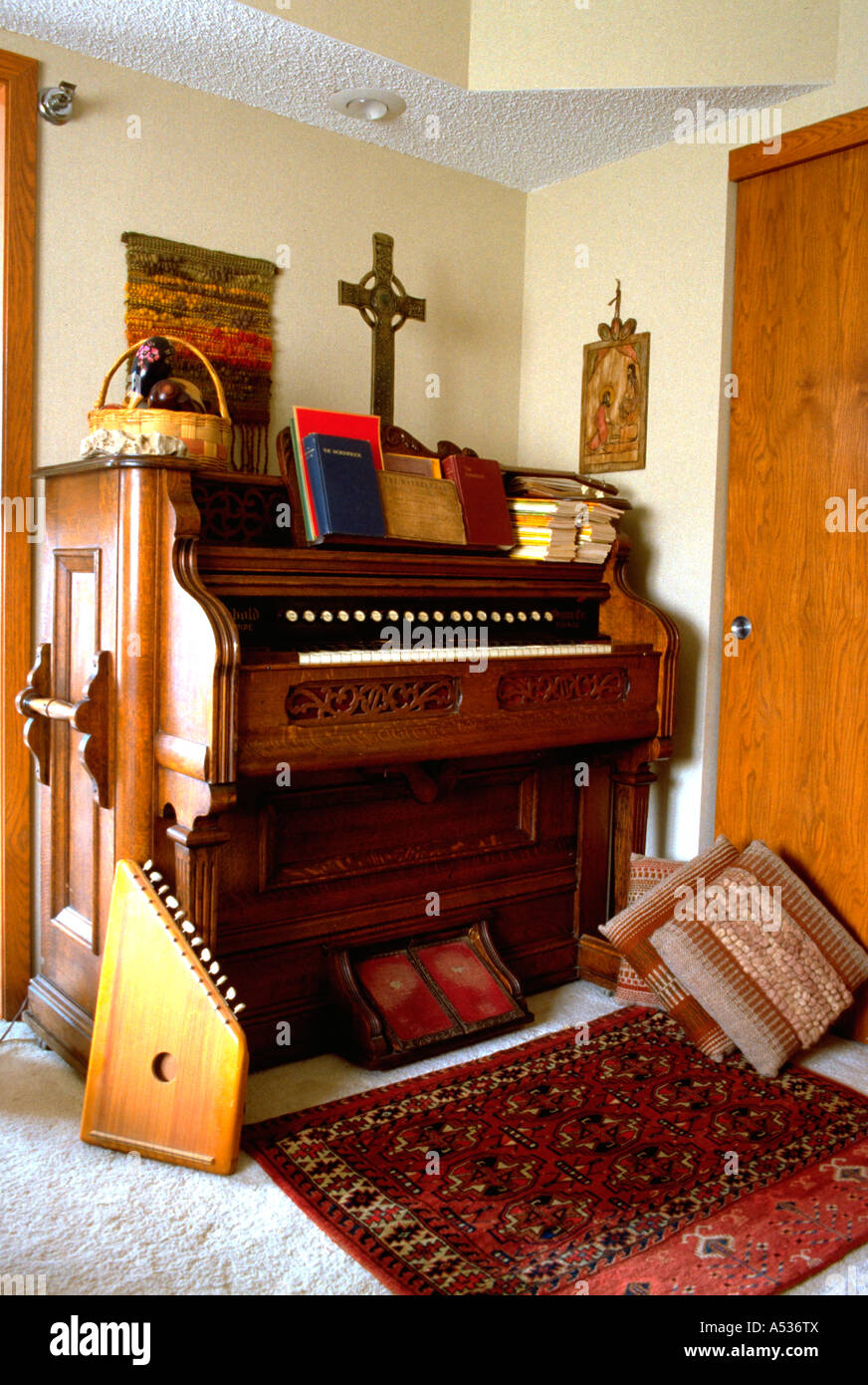 Antique pump organ and zither in the home. Minneapolis Minnesota USA - Stock Image