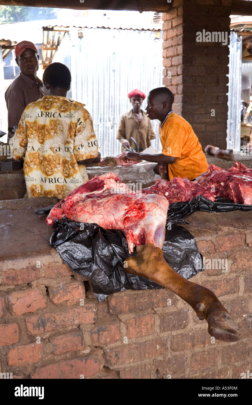 A leg of beef on the butchers stall at the Saturday market in the village of Nkhoma Malawi Africa Stock Photo
