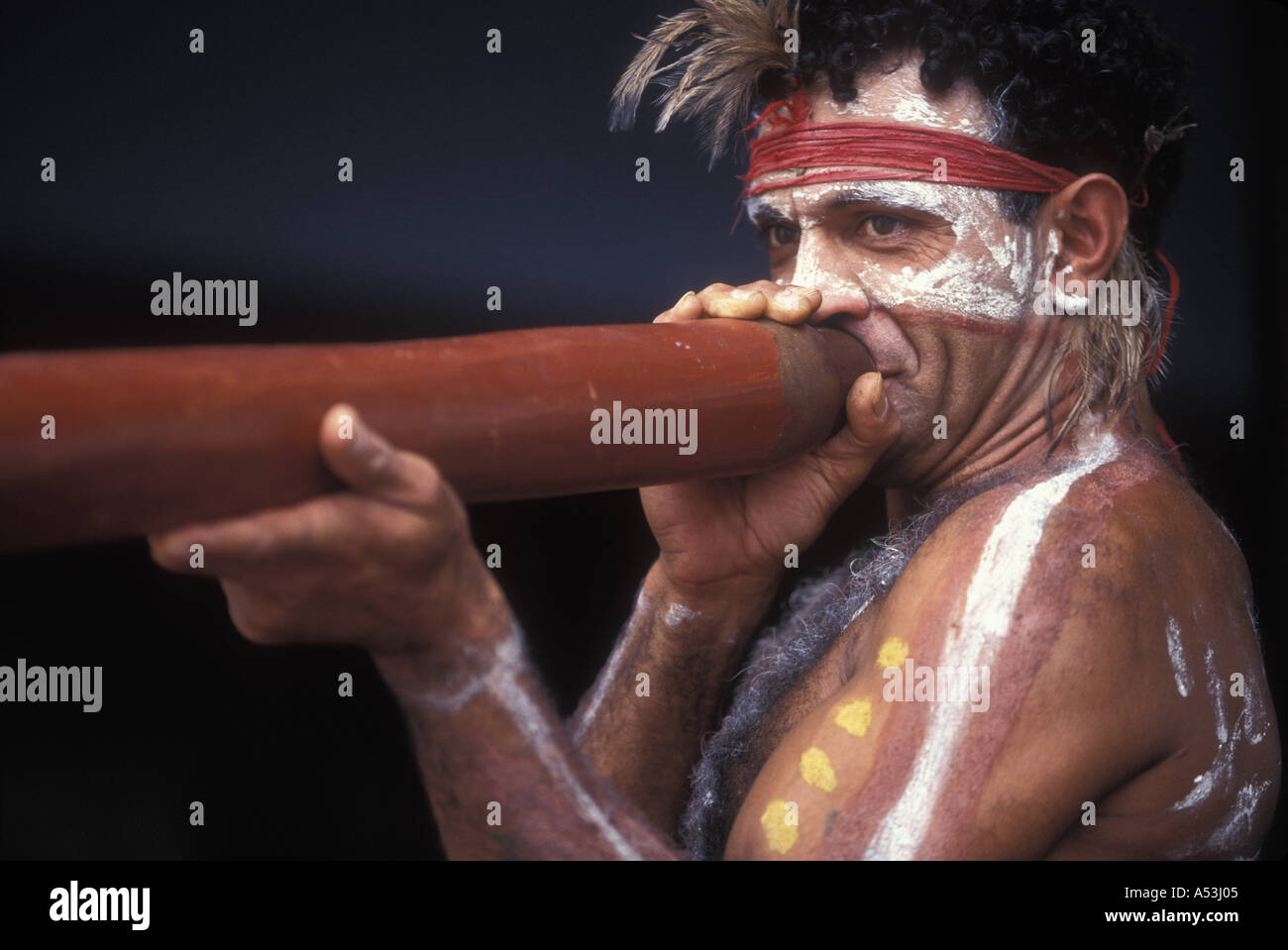 191b93bbe Australia NSW MR David Kennedy wearing traditional Aboriginal face and body  paints plays the dijeradoo in