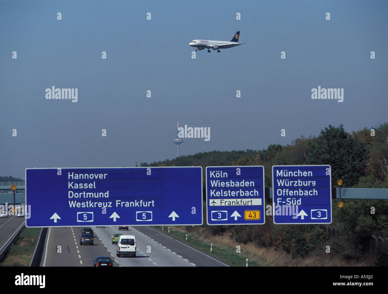 Frankfurt, Germany: Approach of a Lufthansa Airbus to the Frankfurt airport directly above the Frankfurt Autobahn crossing - Stock Image