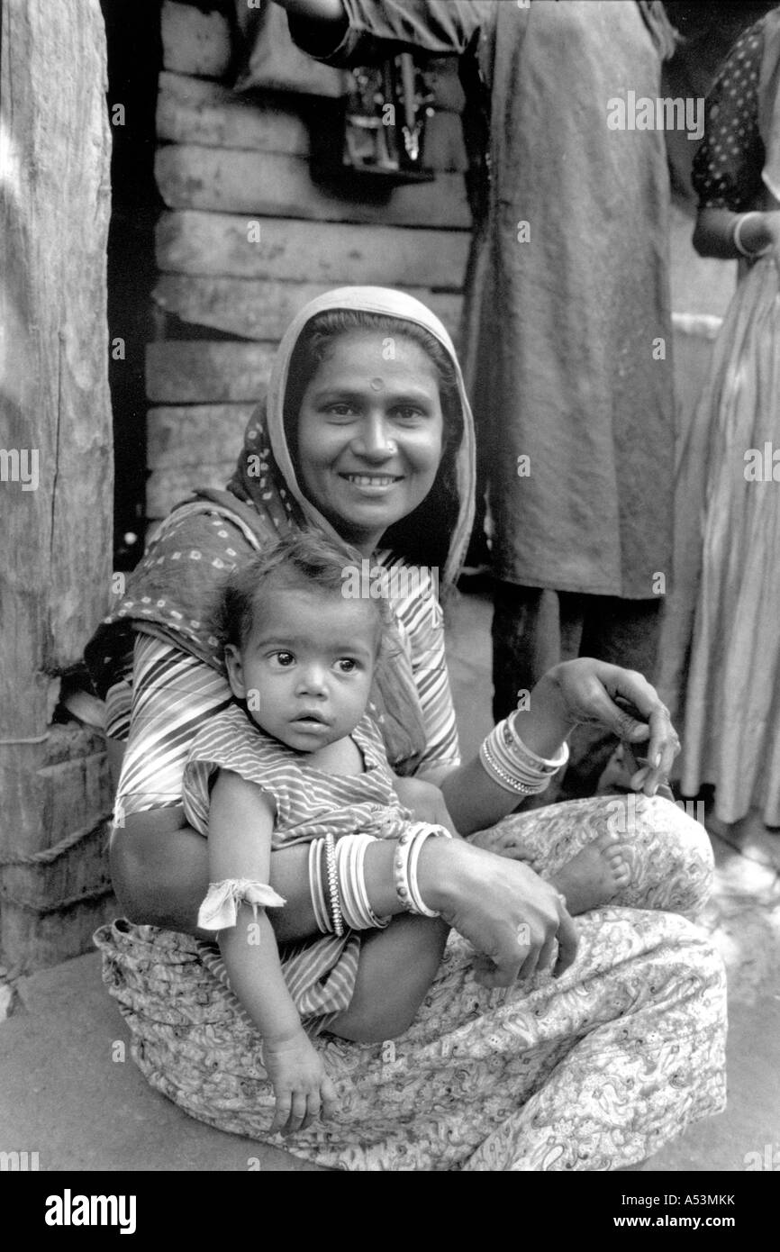 Painet ha1428 253 black and white women babies motherand child ahmedabad gujarat india country developing nation - Stock Image