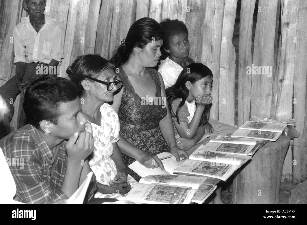 Painet ha1449 274 black and white adult literacy class organised by cntc rural community san pedro sula honduras Stock Photo