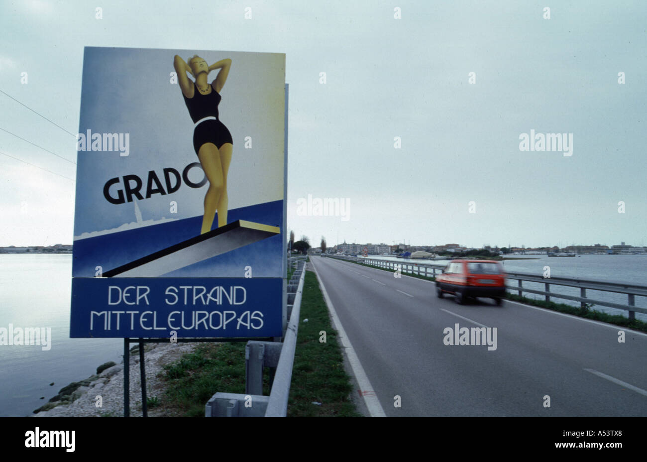 Ad for the beach of Grado with a pin up girl - Stock Image