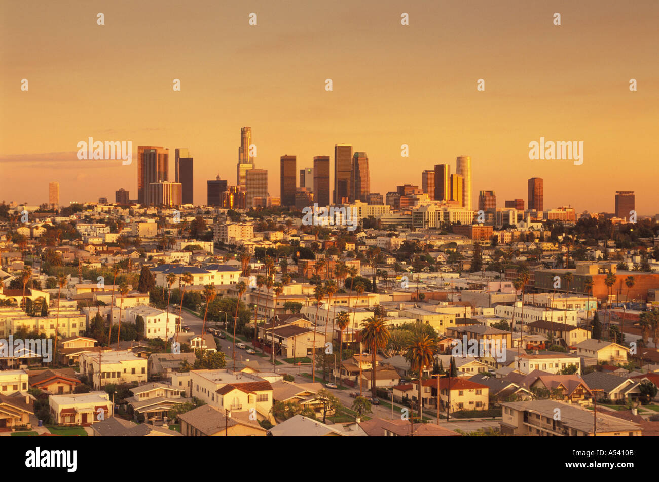 Overview of East Los Angeles and Civic Center above urban sprawl at sunset - Stock Image