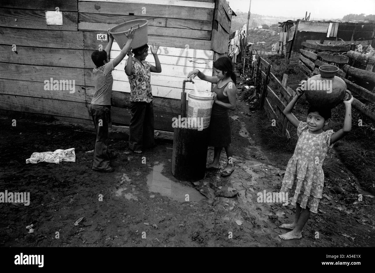 Painet hn1969 564 black and white water taking public standpipe slum guatemala city country developing nation less - Stock Image