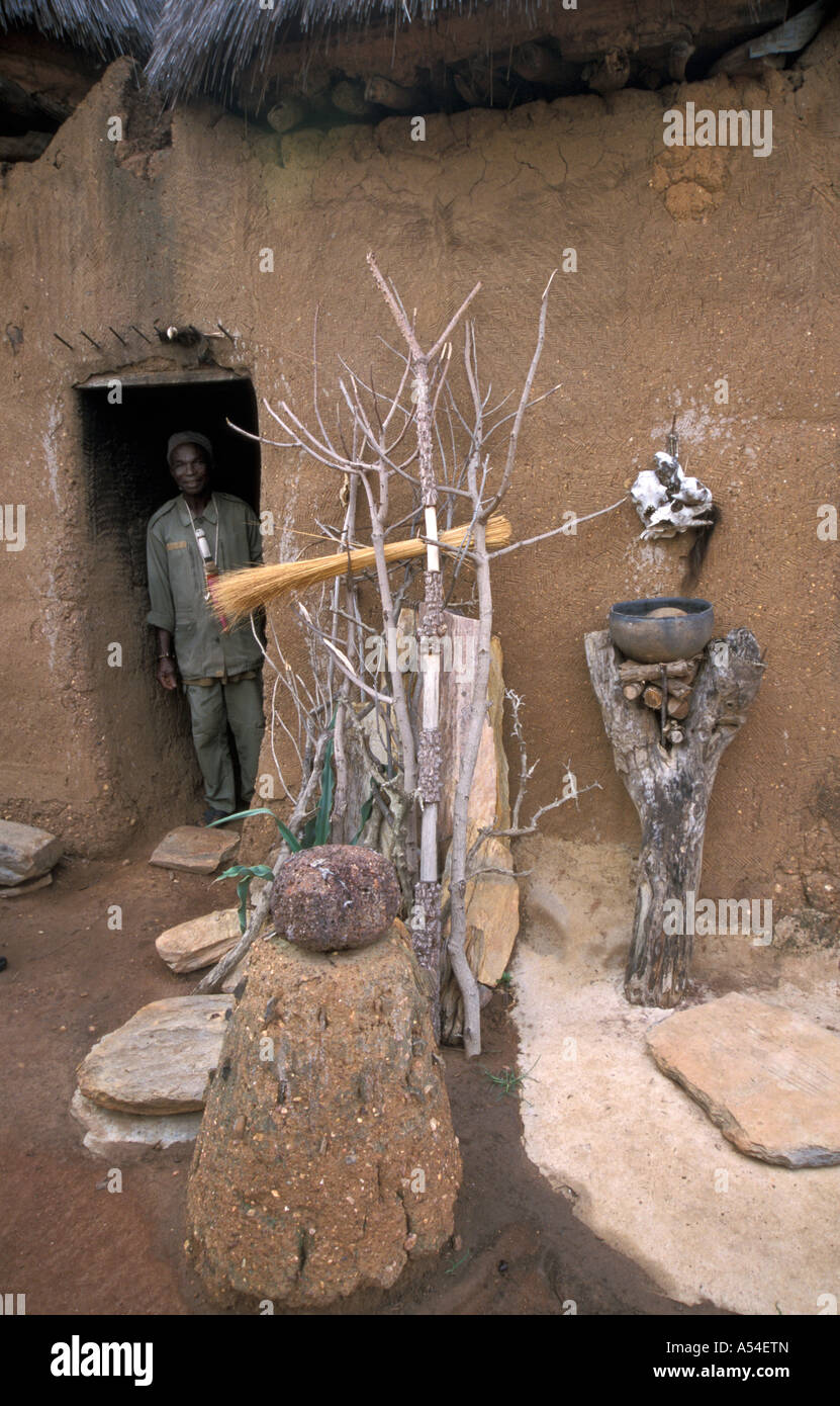 Painet hn2047 7492 benin traditional tatassomba house northwest built by betammaribe tribe man stands ghis doorway - Stock Image