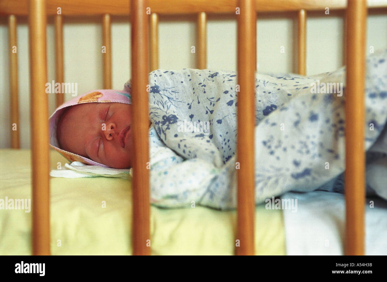 A 4 four days old newborn sleeping in a bed Russia - Stock Image