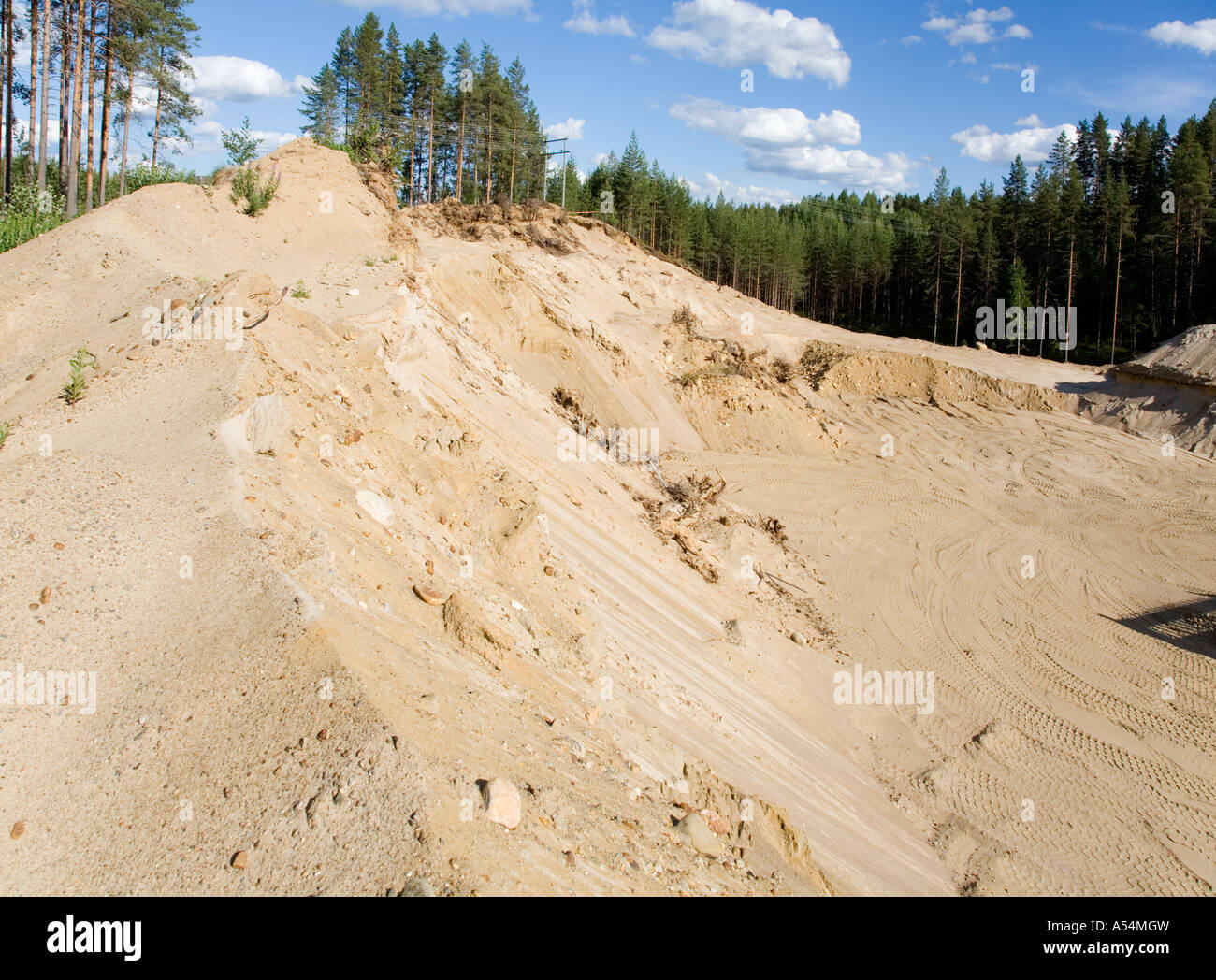 View of a gravel pit at sandy ridge / glacial esker , Finland - Stock Image