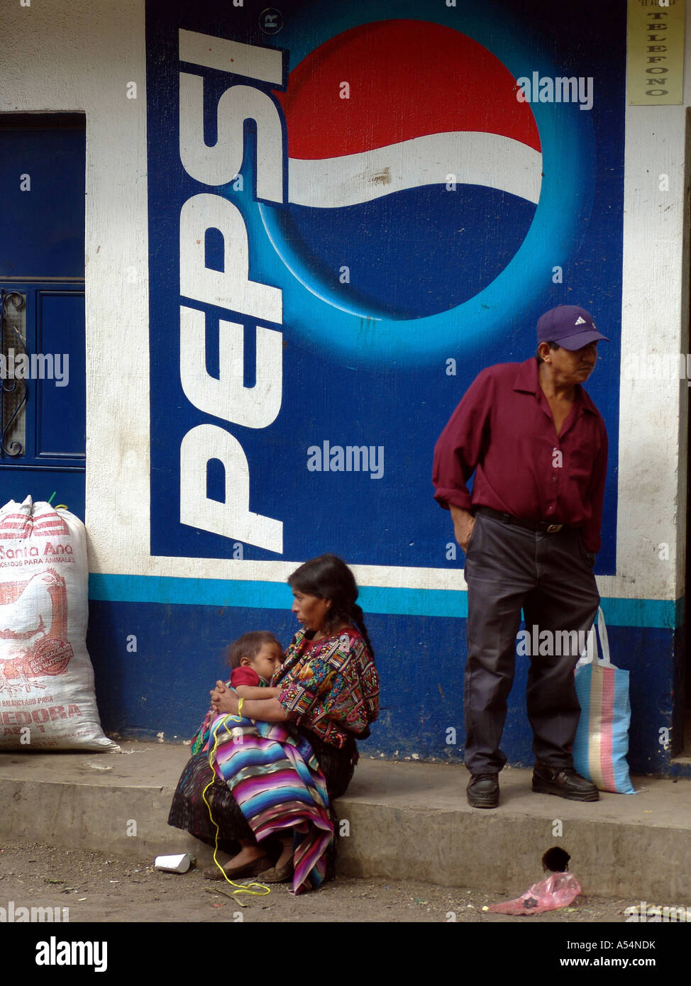 Painet ip1697 guatemala mayans standing pepsi sign san lucas toliman country developing nation less economically - Stock Image