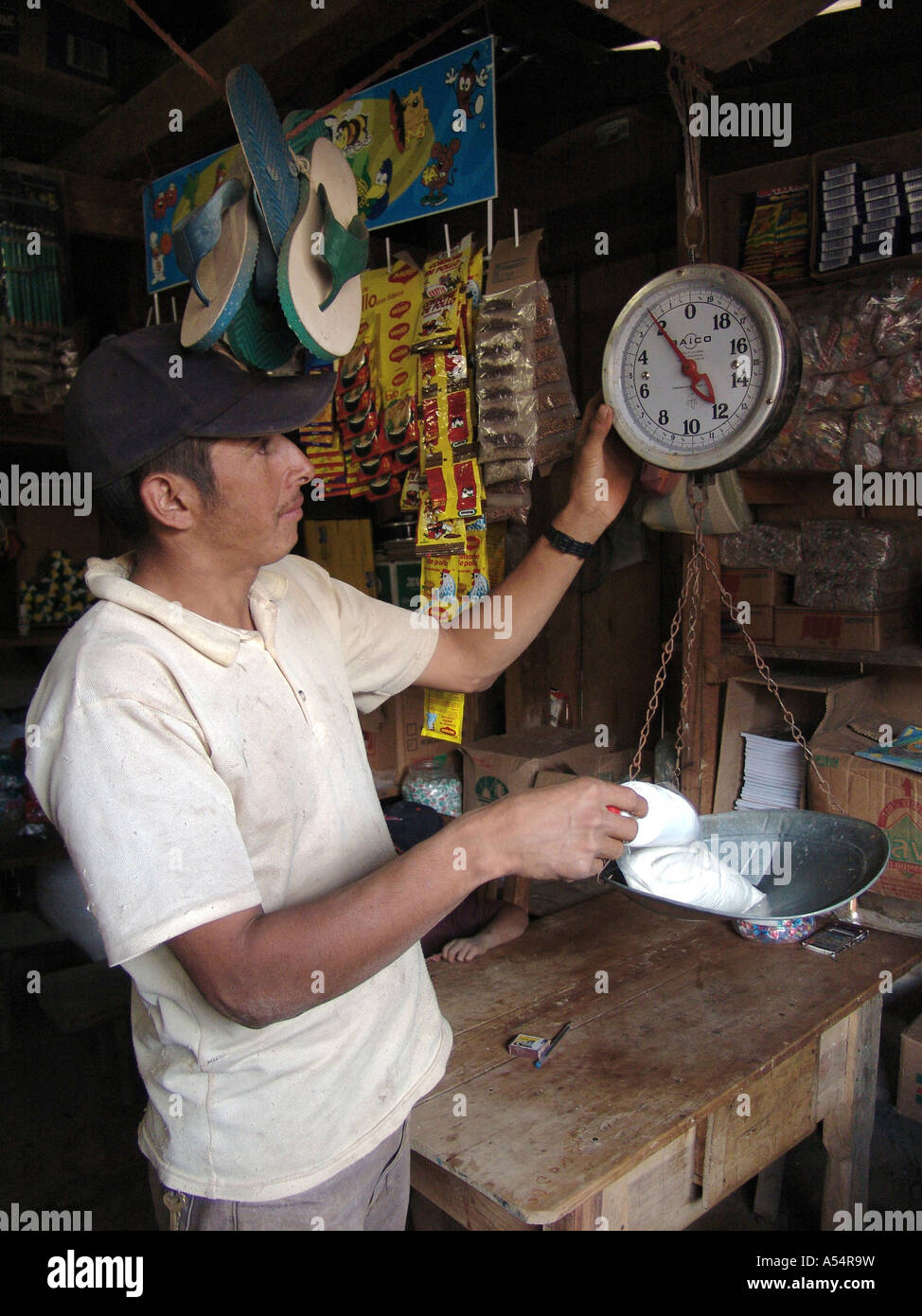 Painet ip1864 honduras man weighing sugar small village shop marcala country  developing nation less economically developed 46051a2b3ce