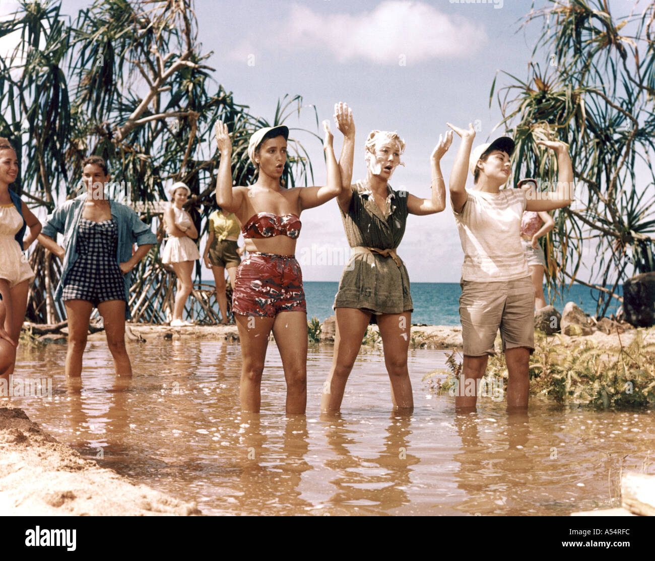SOUTH PACIFIC 1958 film musical with Mizi Gaynor second from right in the Wash That Man sequence - Stock Image