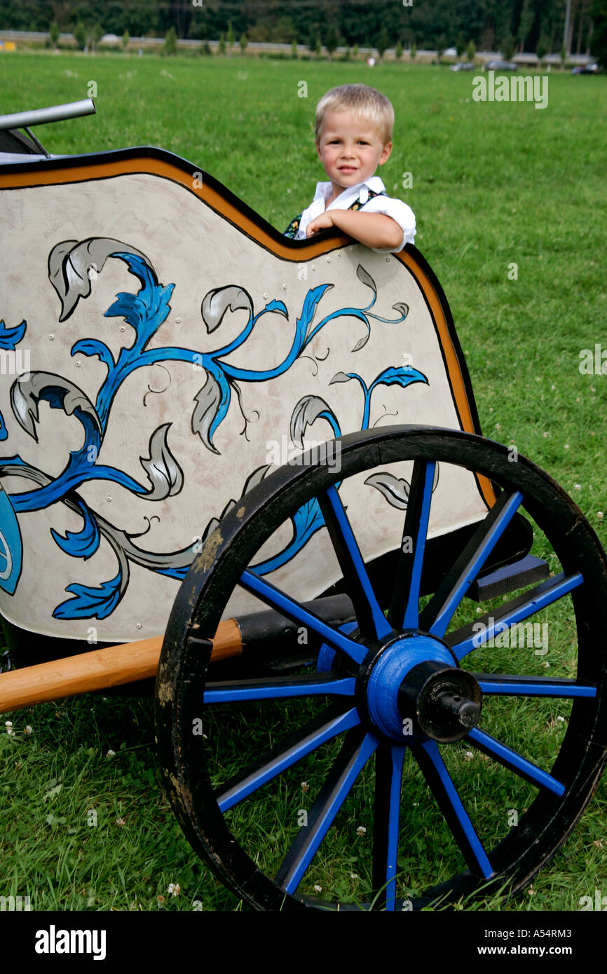 Junior in roman chariot, first oxrace of Bichl, August 8th 2004, Upper Bavaria, Germany - Stock Image
