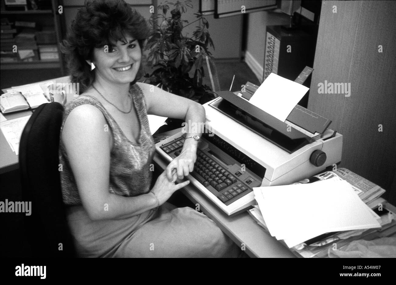 Black and white of Gerry Maynes in her office 1985 with electric typewriter and no computer in sight - Stock Image