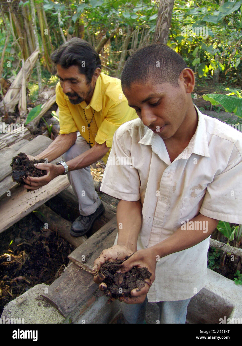 Painet ip2352 nicaragua two farmers father son examining organic compost made worm culture jalapa country developing - Stock Image