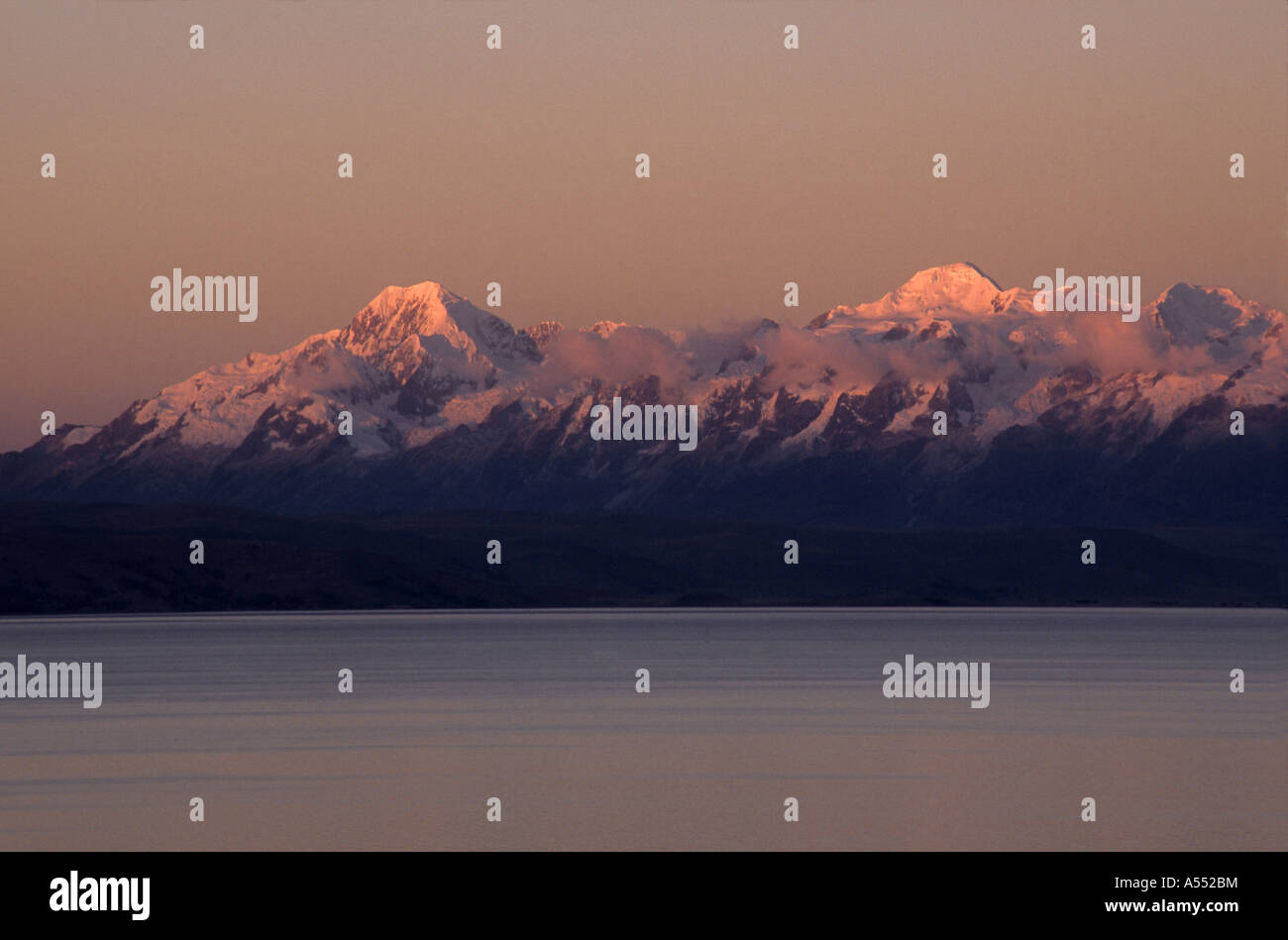 Mts Illampu (L) and Ancohuma (R) at sunset seen from Moon Island / Isla de la Luna, Cordillera Real, Lake Titicaca, - Stock Image