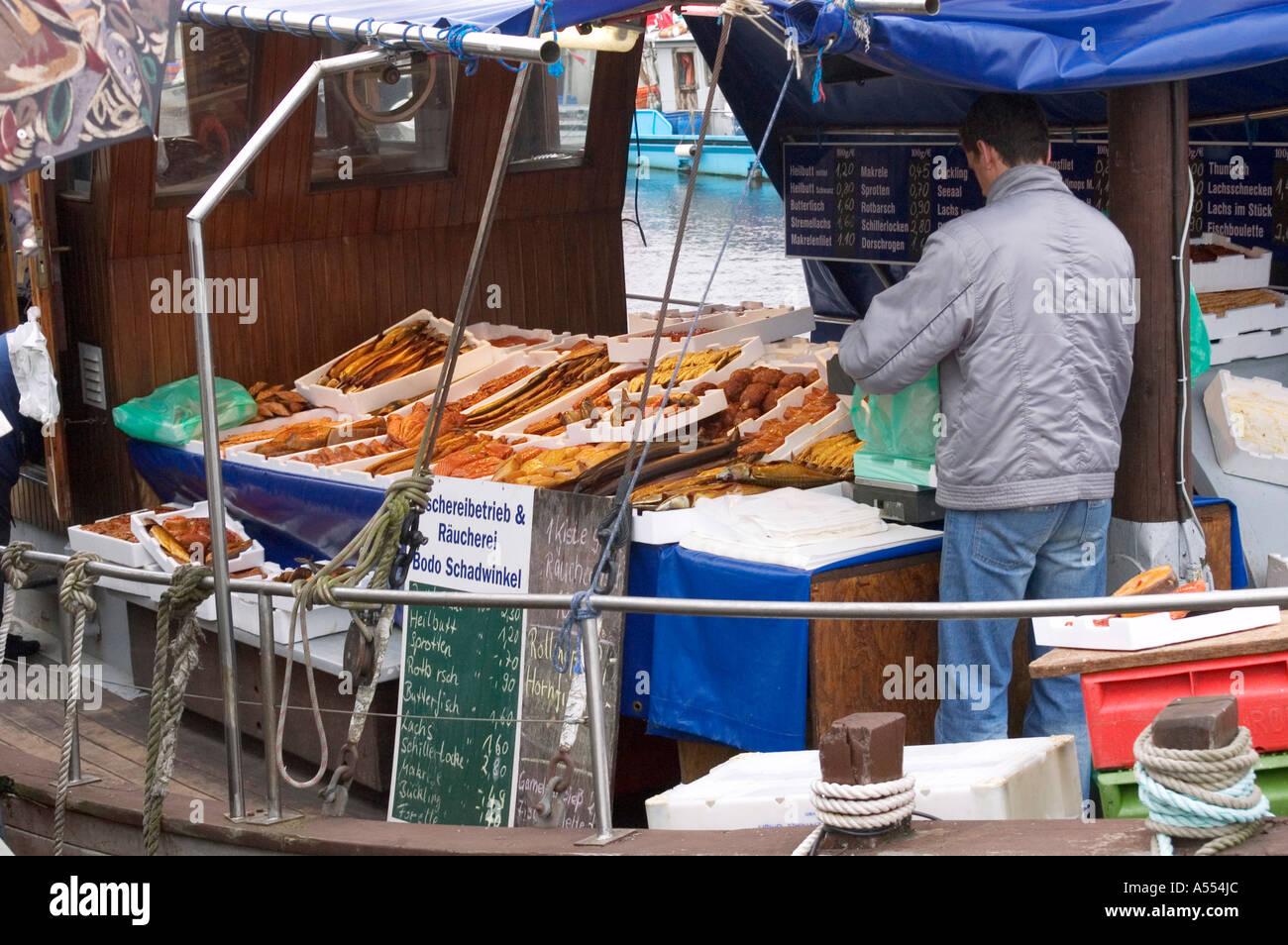 Wismar Mecklenburg Vorpommern Germany fish seller at the harbour - Stock Image