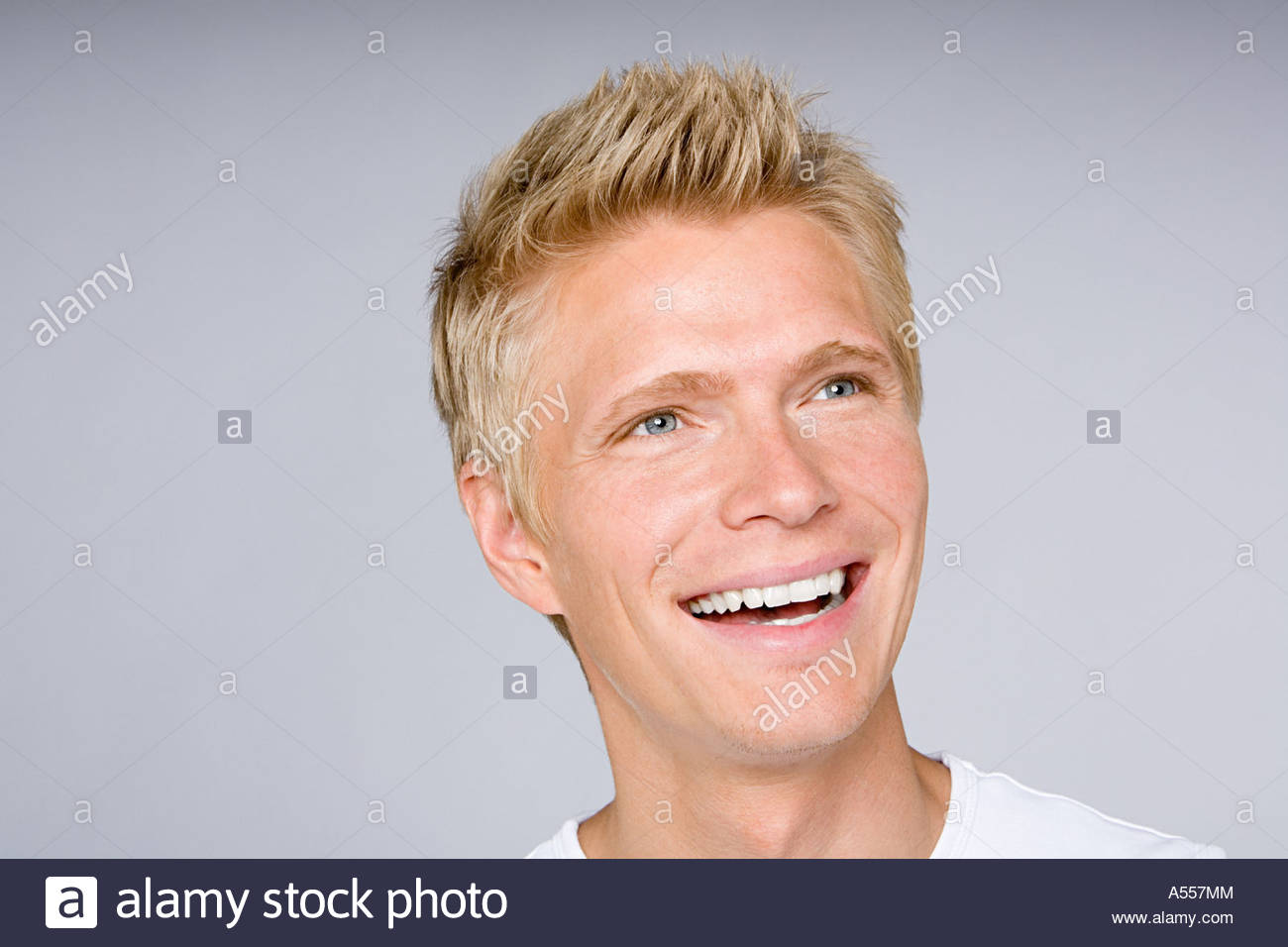 Portrait of a smiling young man - Stock Image