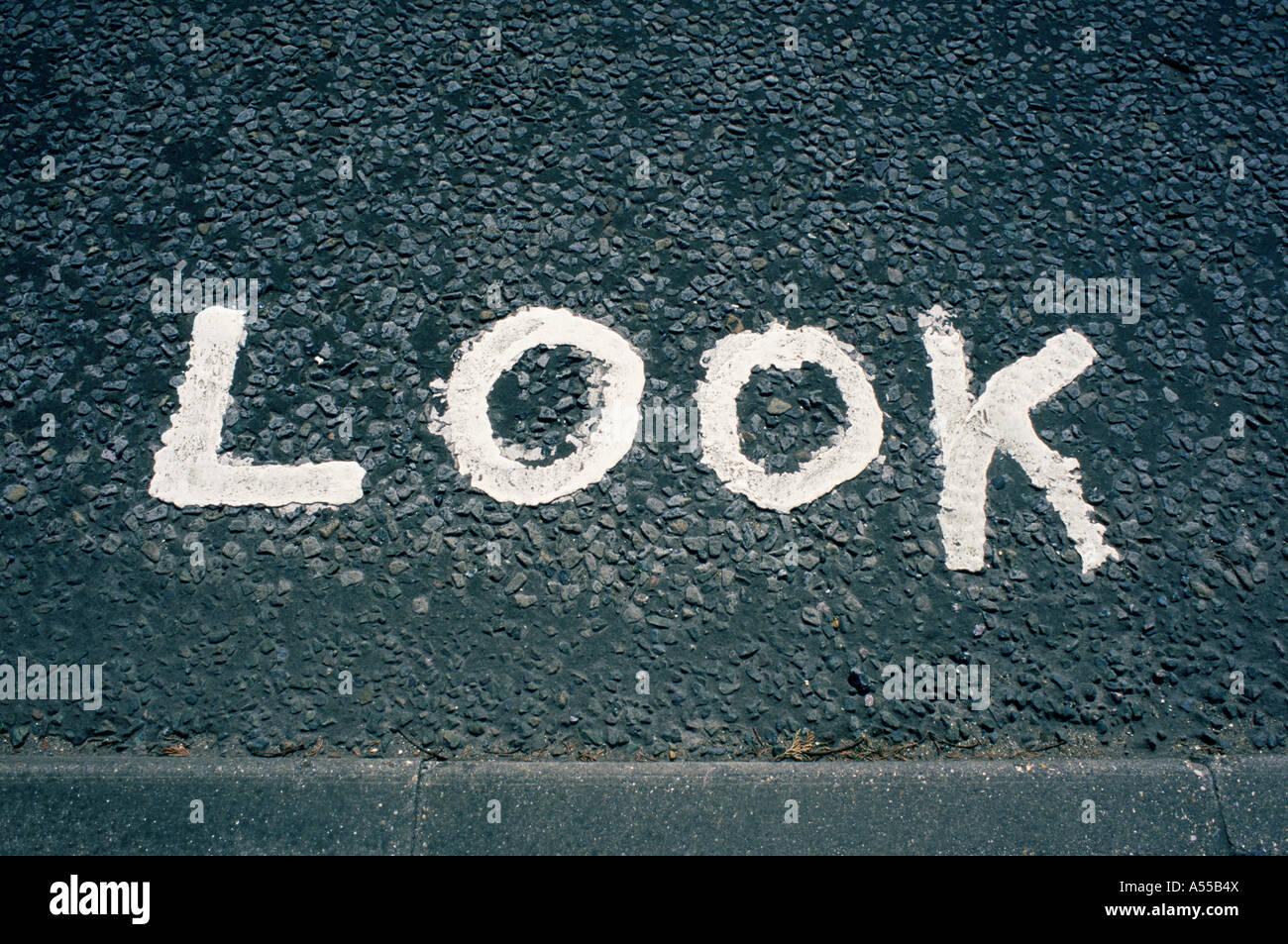 Look written on road - Stock Image