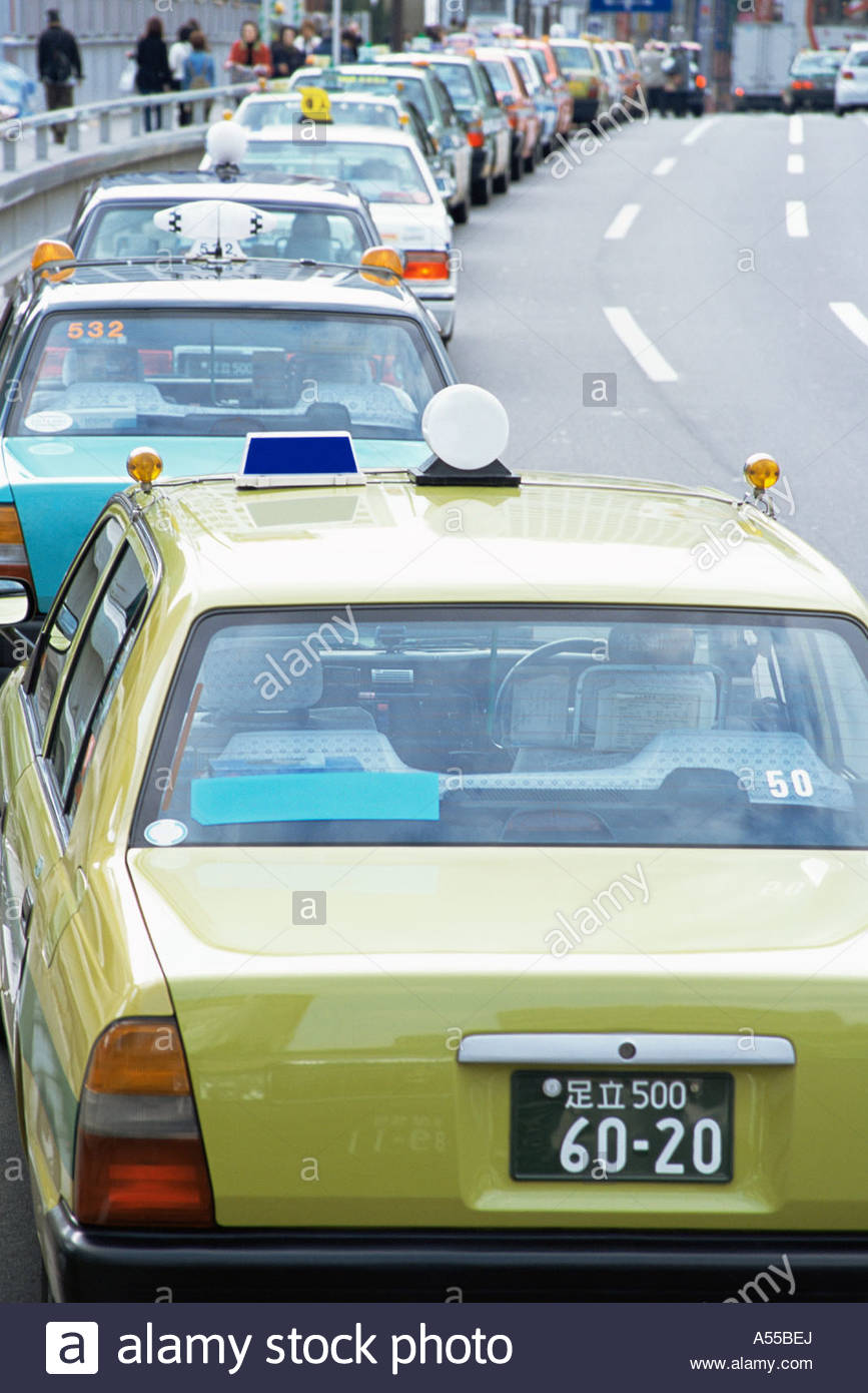 Queue of taxicabs - Stock Image
