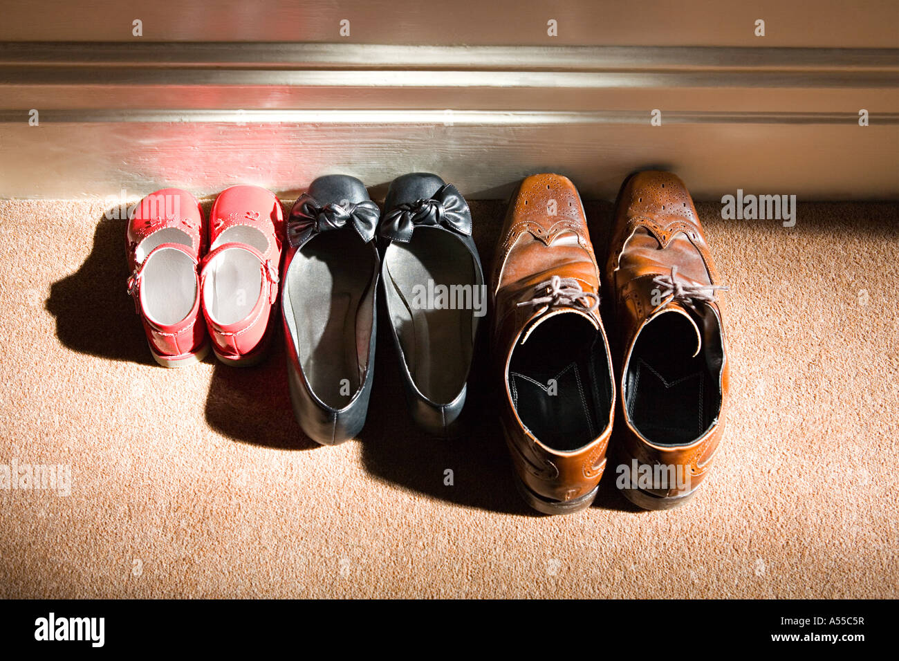 Shoes of a family - Stock Image