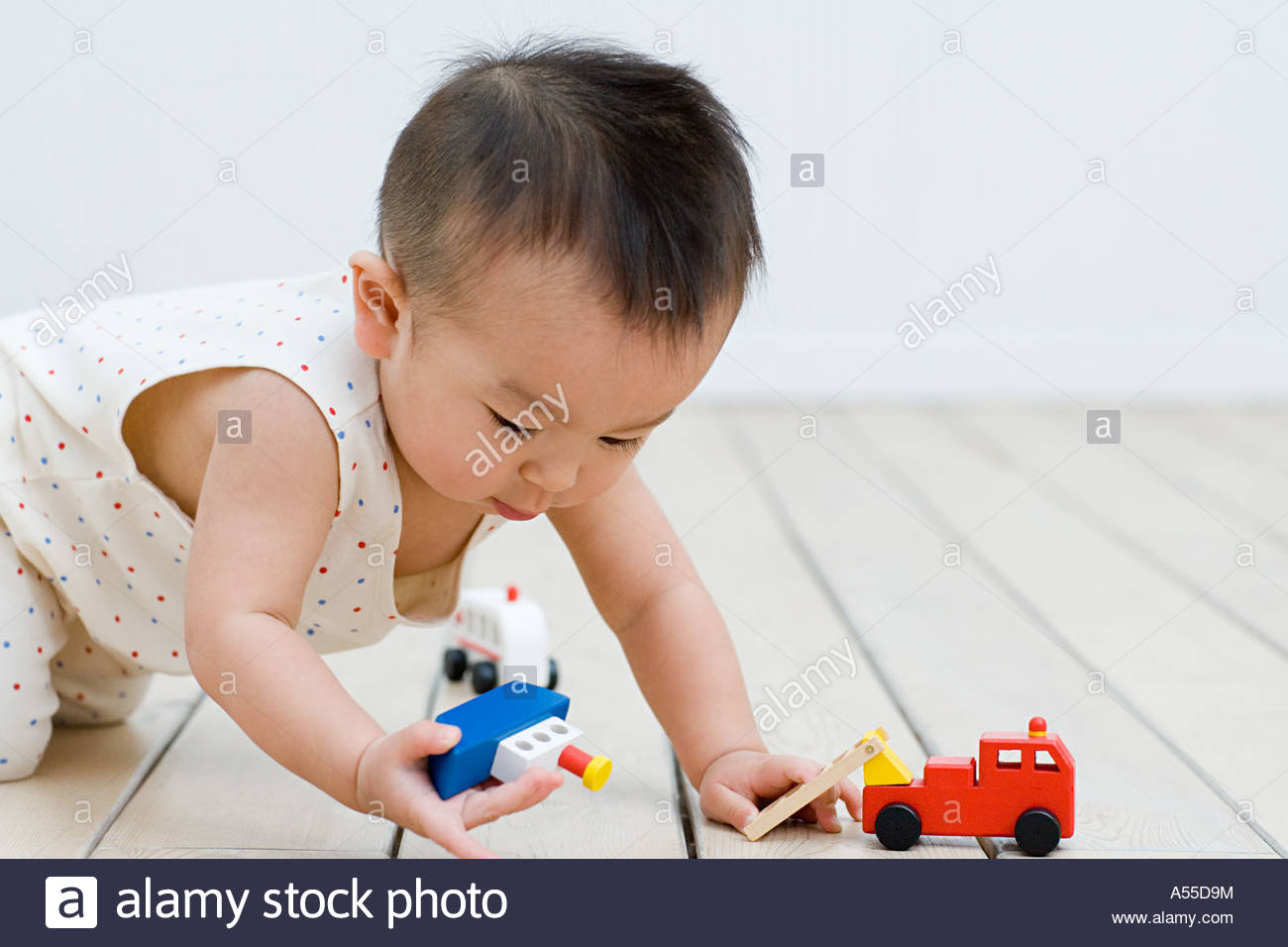 Asian boy playing with toys - Stock Image
