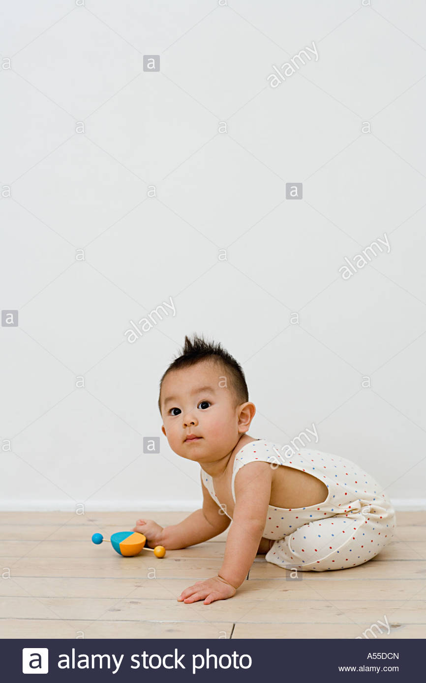 Baby playing with a toy - Stock Image