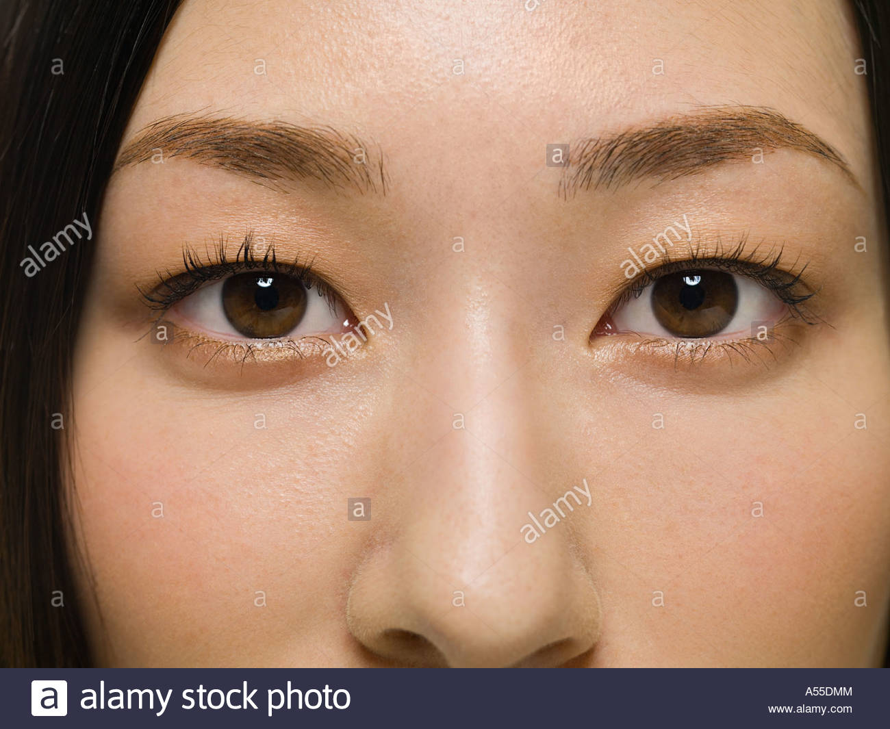 Young womans eyes - Stock Image