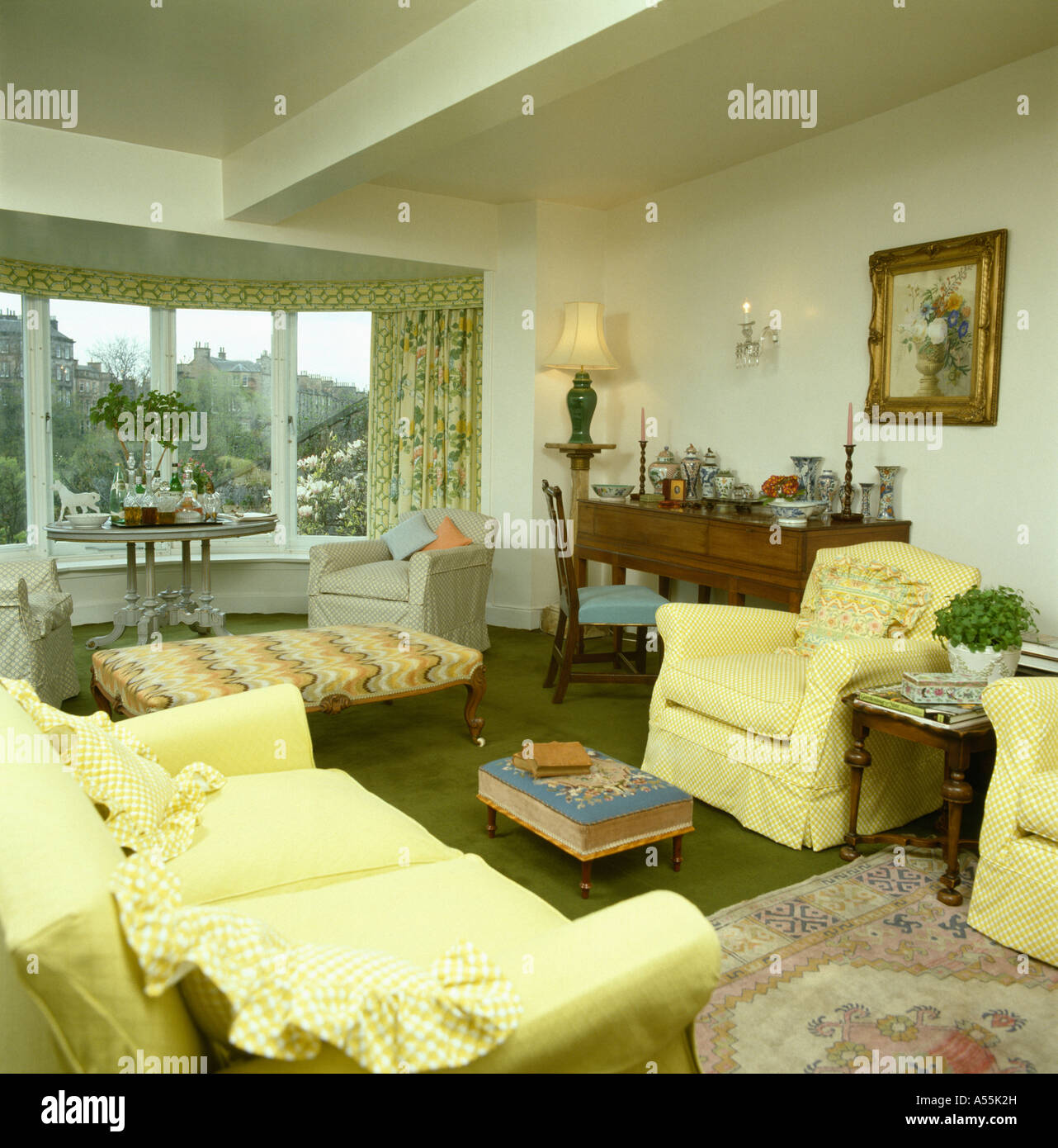 pale yellow settee and armchairs in traditional apartment living