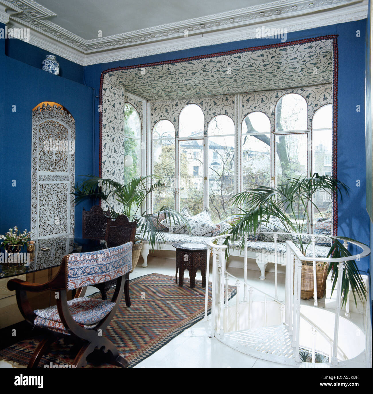 bay window dining room floor to ceiling blue eighties diningroom with bay window and contrasting wallpaper