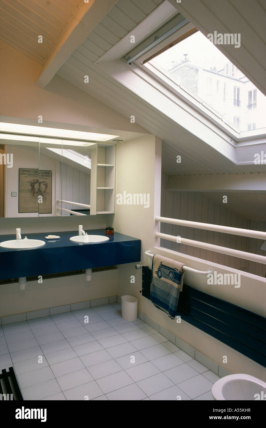 Modern loft conversion bathroom with velux window and double basins in black vanity unit - Stock Image