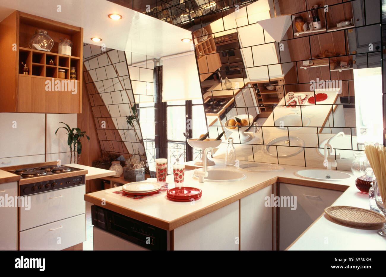 Small Attic Eighties Kitchen With Mirror Tiles On Sloping Walls