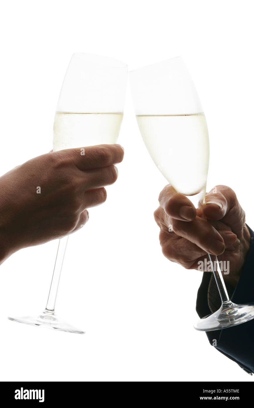 Young, middle age woman and senior man toasting champagne, side view, close-up - Stock Image