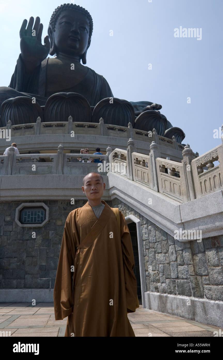 Monk at the Giant Bronze Buddha on Lantau Island in Hong Kong - Stock Image