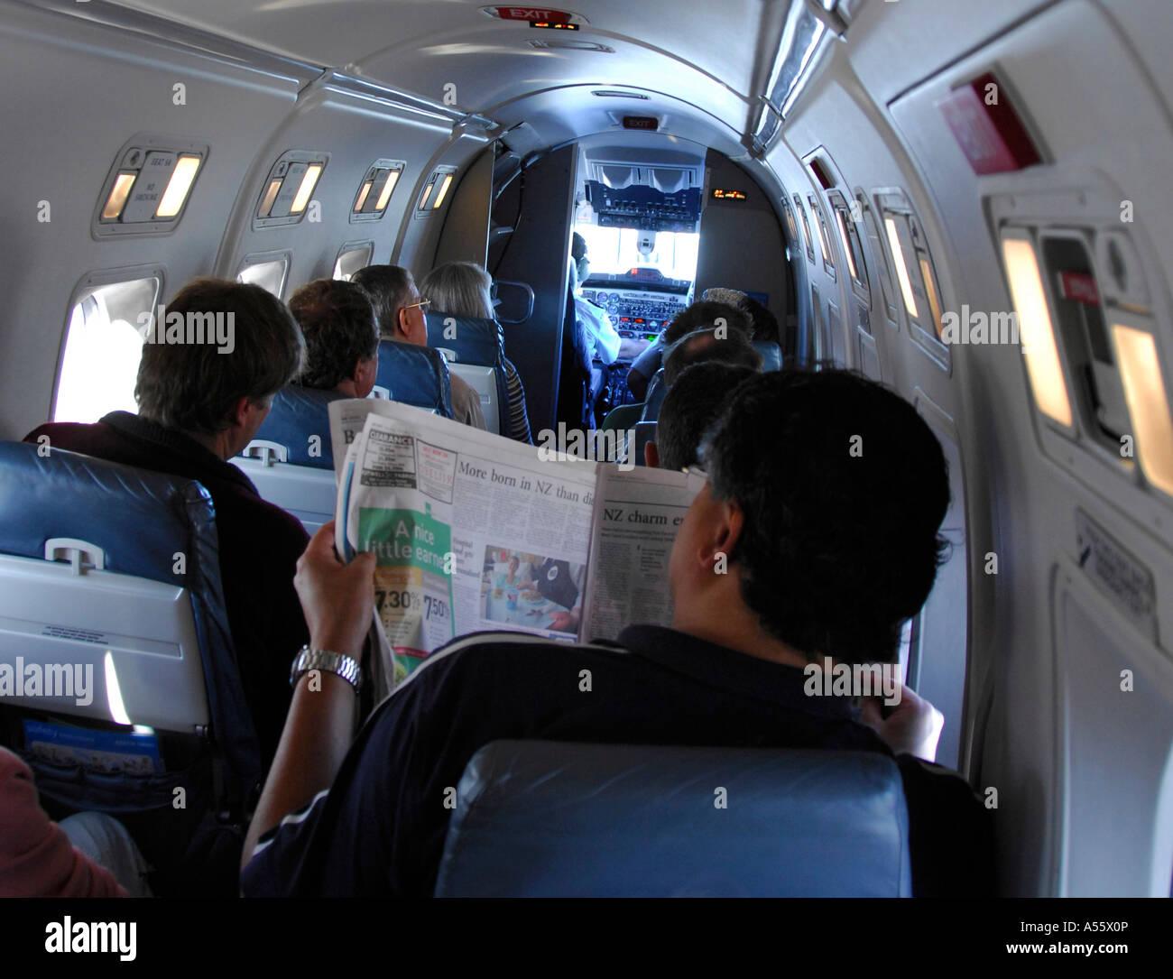 Airline passengers on Air New Zealand Beech1900D commuter aircraft during flight, February 2007 - Stock Image