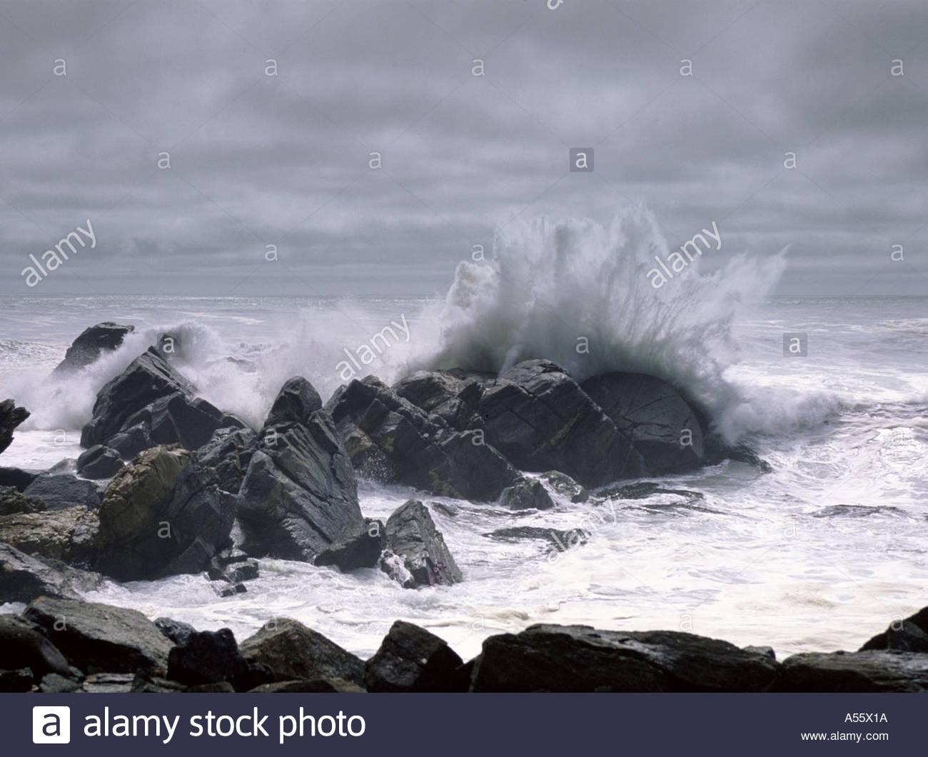 Waves crashing against rocks, Cape Foulwind, West Coast, South Island, New Zealand - Stock Image