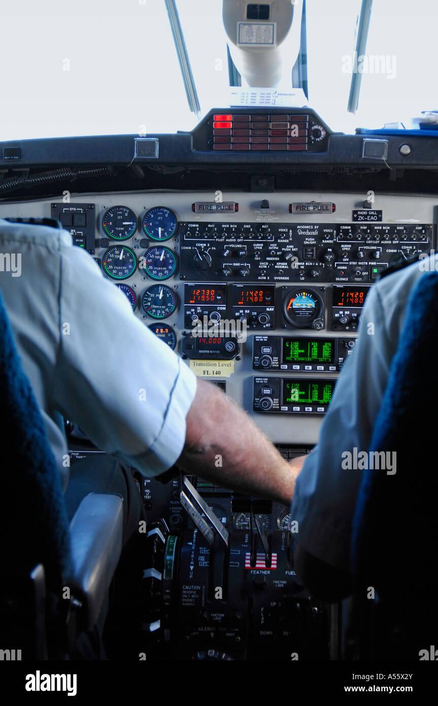 Pilot and copilot at controls of an Air new Zealand Beech1900D passenger commuter aircraft, New Zealand February - Stock Image