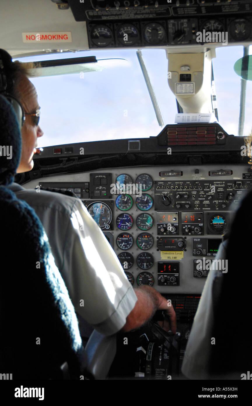 Pilot at controls of an Air new Zealand Beech1900D passenger commuter aircraft, New Zealand February 2007 - Stock Image