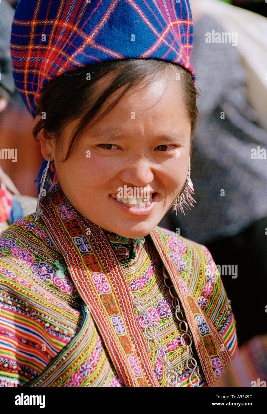 Portrait of a woman of the Hmong Tribe in traditional dress at the market in BacHa Northern Vietnam - Stock Image