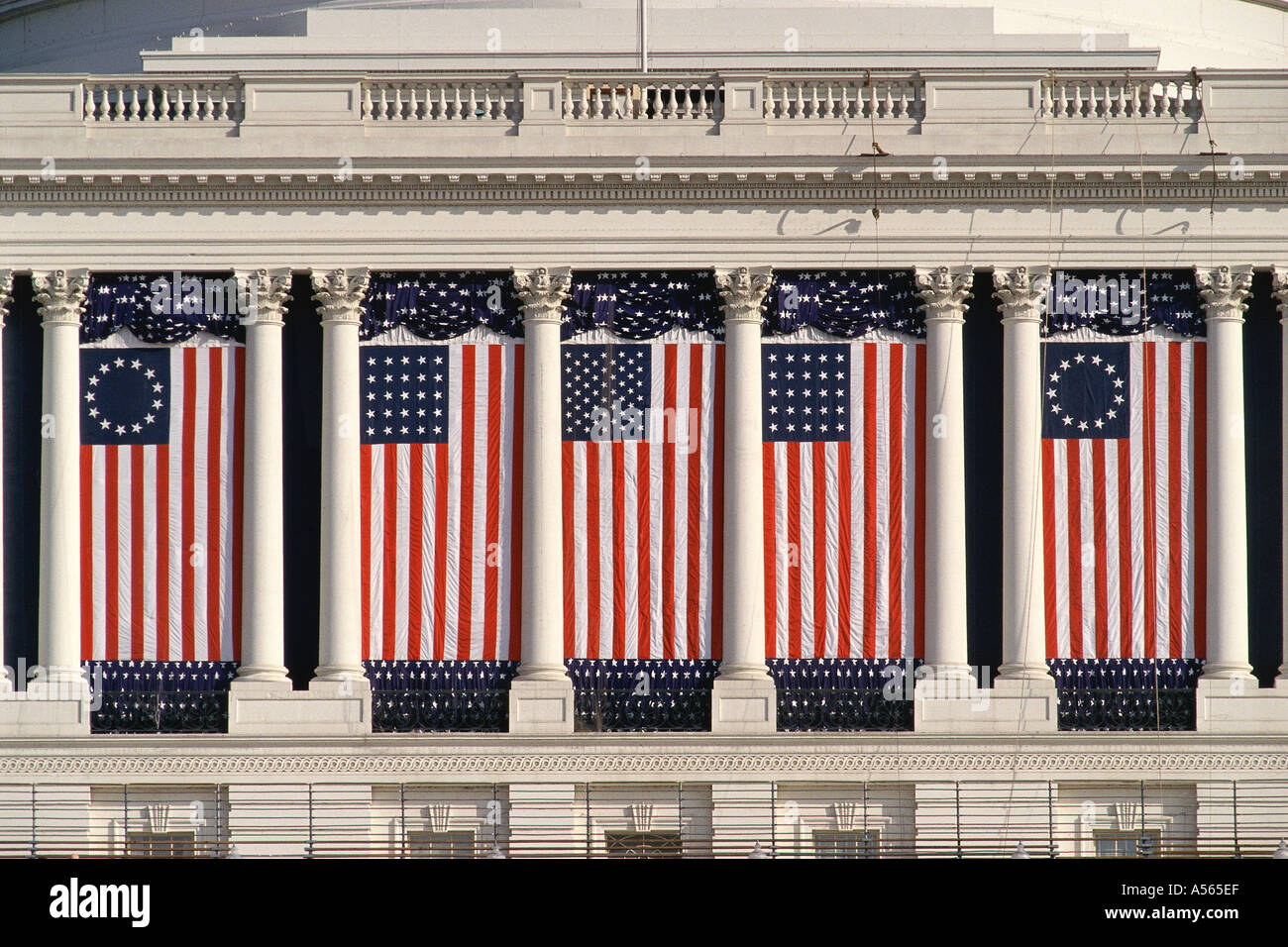US Capitol Building with American flags draped between columns - Stock Image