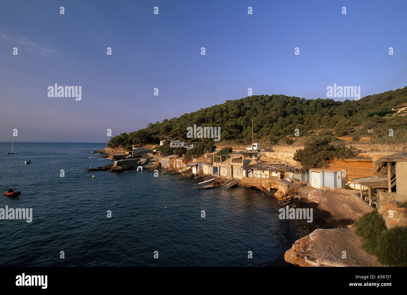 Boathouses in Sa Canal in Ibiza Spain - Stock Image