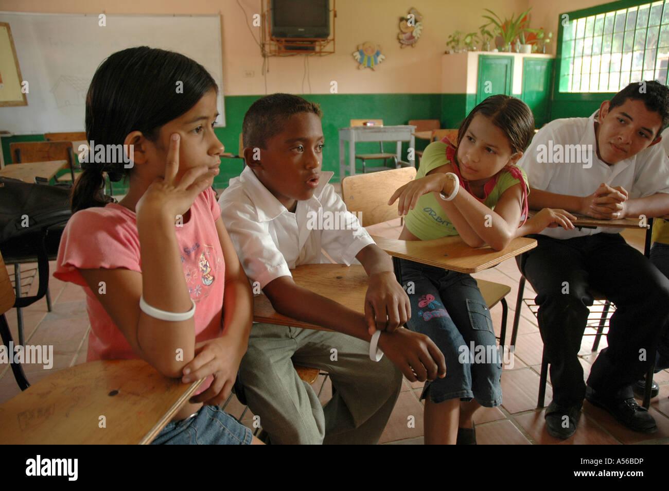 Painet iy8254 students teacher colombia extracurricular seminar middle school paz barrancabermeja children kids - Stock Image